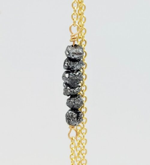 black diamonds yellow gold earrings
